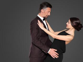 Happy mature couple on dark background