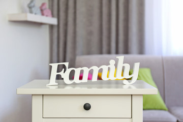 Wooden text Family in modern interior