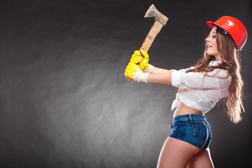 Sexy strong woman feminist with axe working.