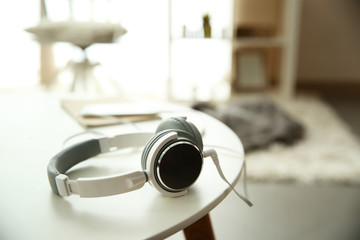 New headphones on the table in the room