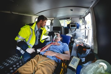 Injured man with ambulance man