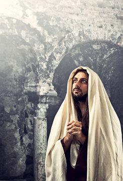 Jesus Christ prays with clasped hands
