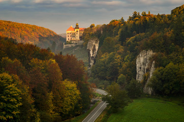 Sunrise at Pieskowa Skala Castle among autumn trees, Poland Wall mural