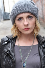 Blond hipster girl with a nose ring