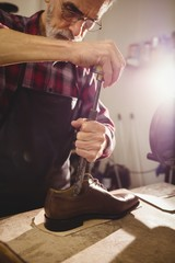 Portrait of cobbler making shoes