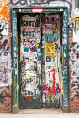 Graffiti covered doorway in New York City