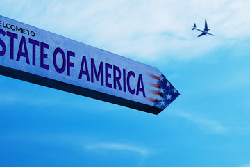 Plane on Sky  and United State of America Sign Board