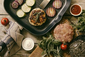 Preparing black burger and ingredients