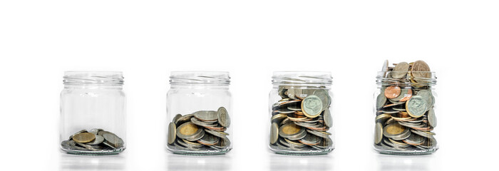 Money saving, glass jar arrange with coins inside growing, on white background