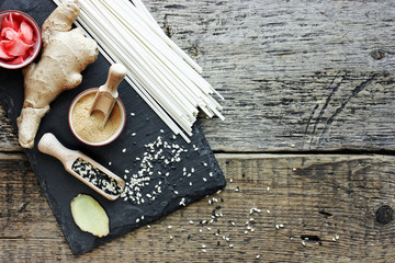 Set of traditional Asian food on a dark wooden background