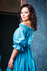 portrait of beautiful elegant young woman in gorgeous summer dress