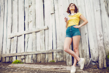 Funny Hipster Girl over white old wooden wall, hipster outfit Going Crazy at tropical island.Trendy Casual Fashion Outfit in summer,spring.Toned Photo,Copy Space.