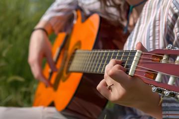 Hands of female Musician playing Gu