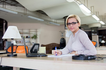 woman in the office with a laptop