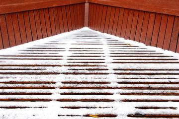 the snow on the wooden slats floor