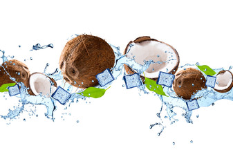 Water splash with fruits isolated on white background. Fresh coconut