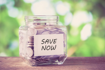 save money for investment concept money in the glass with filter