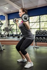 Woman working out with barbell