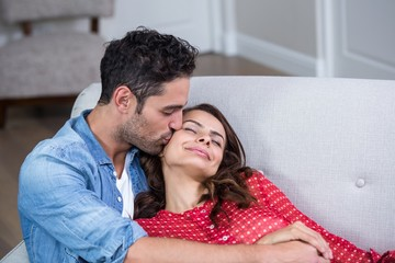 Man kissing woman with eyes closed