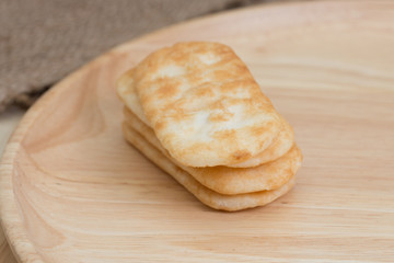 japanese rice cracker on wooden plate.