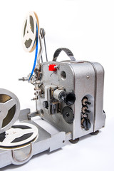 Vintage motion picture film projector and reel of motion picture