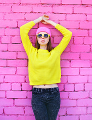 Fashion portrait pretty woman over colorful pink background