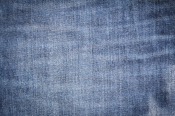 Closeup denim jeans texture. Stitched textured blue jeans denim fabric background. Old grunge vintage denim jeans.