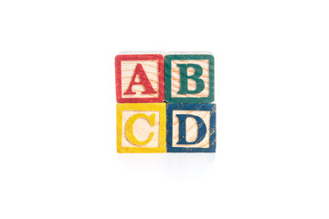 photo of a alphabet blocks spelling ABCD isolate on white backgr
