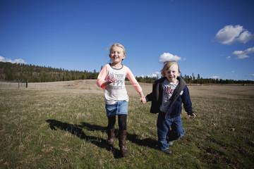 Two Kids Run Through Field