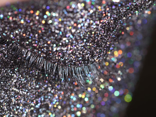 Close up of a woman's closed eye with glittering make up