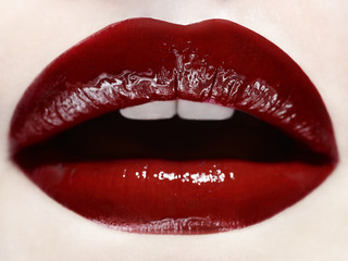 Close up of woman's mouth wearing red lipstick