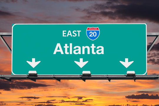 Atlanta Interstate 20 East Highway Sign with Sunrise Sky
