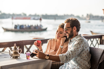 Couple relaxing in outdoor cafe