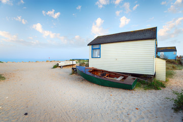 Boats and beach huts at Mudeford Spit near Christchurch in Dorset