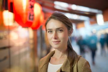 Portrait of businesswoman on city street at night