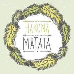 Frame of feathers and an inscription- hakuna matata