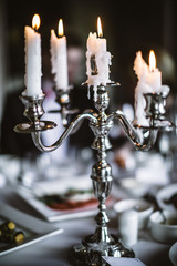 Elegant Antique Candlestick on the Served Table