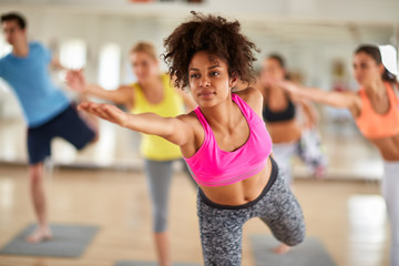 Close up of young woman on stretching training indoor