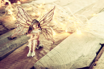 image of magical little fairy in the forest . vintage filtered