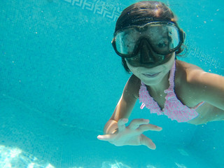 Little girl playing under water