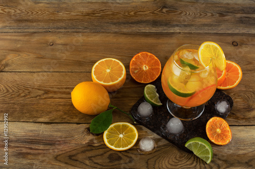 "Iced tropical fruit cocktail on wooden table top view"" Arkivfoton och ..."