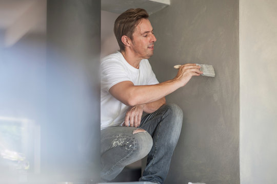 Builder painting wall