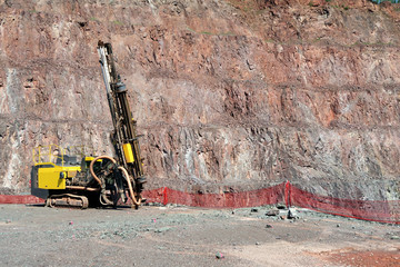 Driller in an open pit mine