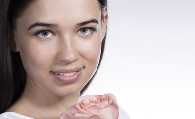 Young attractive woman with rose flower