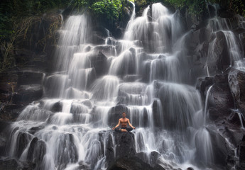 serenity and yoga practicing at waterfall Kanto Lampo, Bali,Indonesia