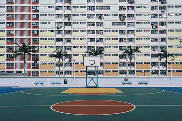 Urban Oasis - Basketball court on a pastel skyscraper front.