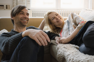 Happy mature couple spending leisure time at home