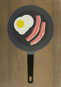 Directly above shot of bacon and egg in frying pan