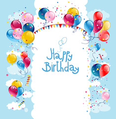 Birthday balloons in blue sky