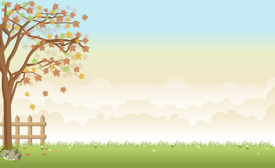 Green grass landscape with a tree, flowers and clouds